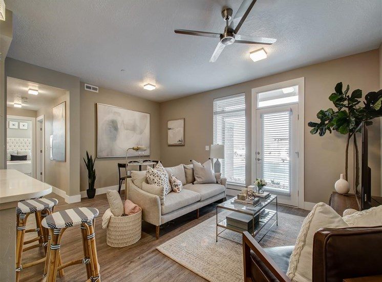 Model Living Room with Hardwood Style Flooring,  Couch, Coffee Table and Decorations