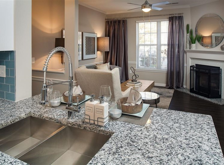 kitchen sink at the breakfast bar with the living room in the background