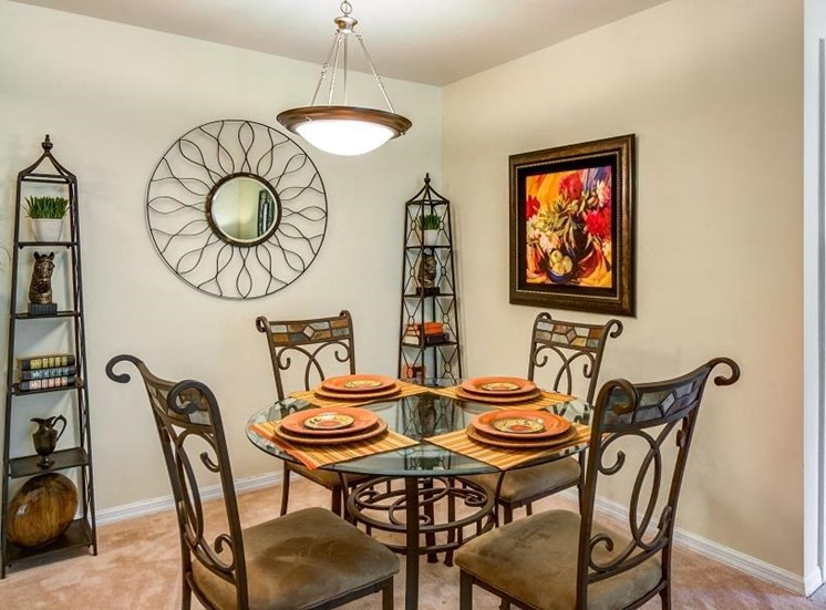 Model Dining Room with Dining Table  with Plates on Placemats with Art on Walls adn on Decorative Shelf