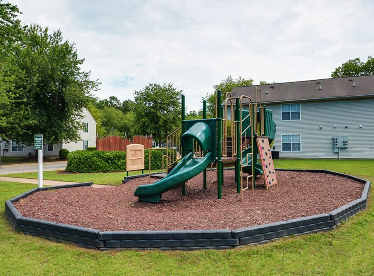 Playground With Wood Chips at King's Ridge Apartments, Newport News