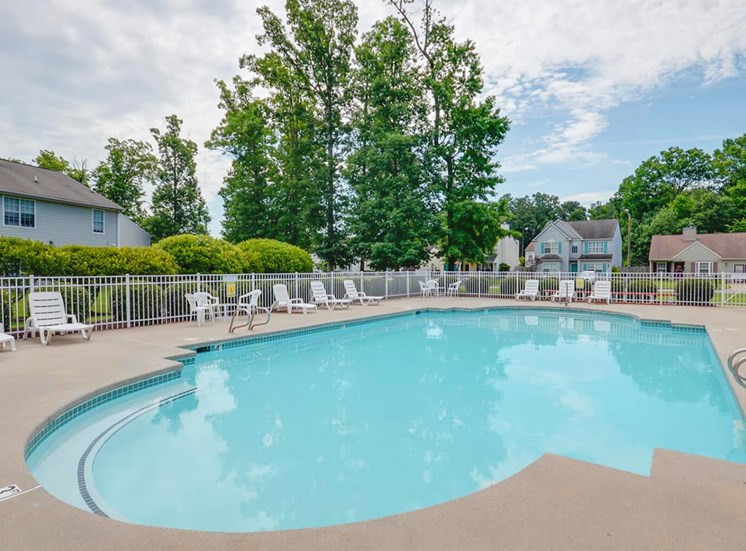 Swimming Pool With Lounge Chairs at King's Ridge Apartments, Newport News, Virginia
