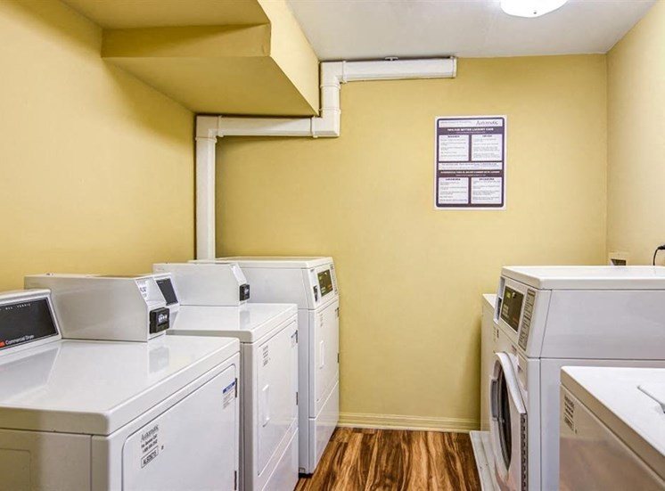 Yellow Laundry Facility with Washer and Dryers