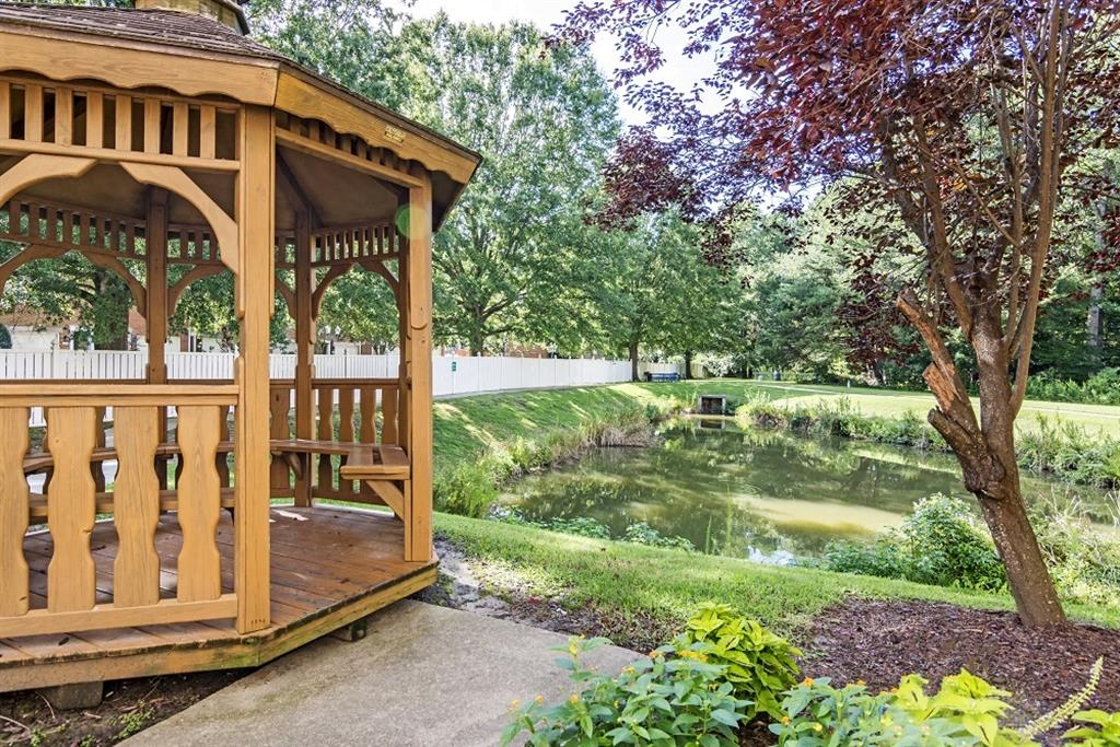 Gazebo with Waterfront View Next to Decorative Tree