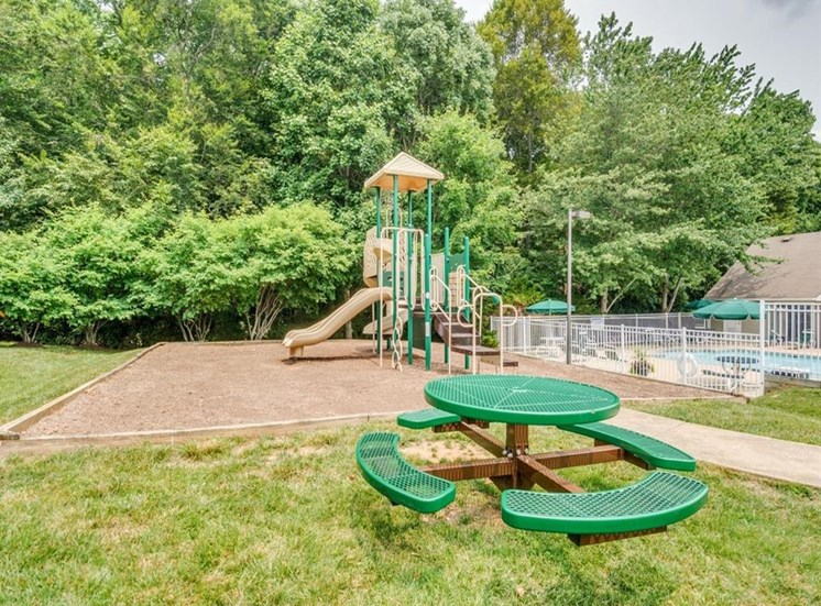 Playground with picnic area near by with grass