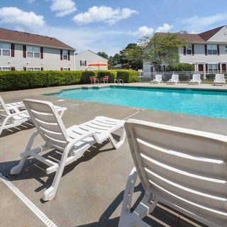 Poolside Sundeck With Relaxing Chairs by the swimmong pool
