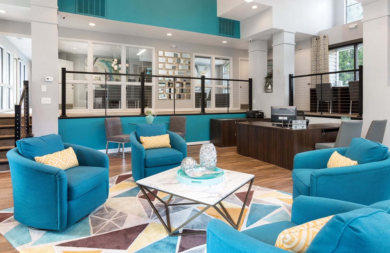 Clubhouse Seating Area with Blue Color Scheme 4 Arm Chairs Surrounding Contemporary Coffee Table