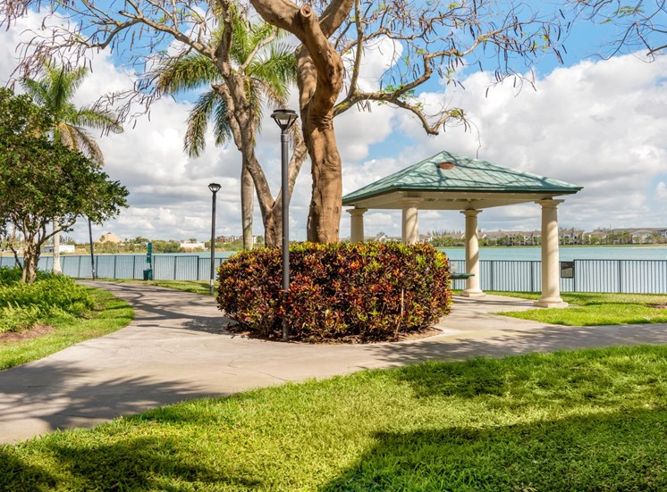 Courtyard with Sidewalks, Shrubs and Trees Next to Picnic Pavilion with Waterfront View
