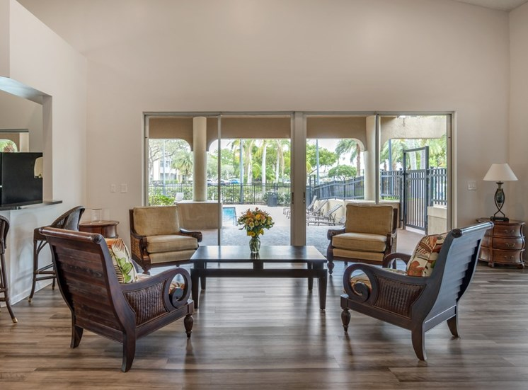 Arm Chairs Around Coffee Table in Front of Windows