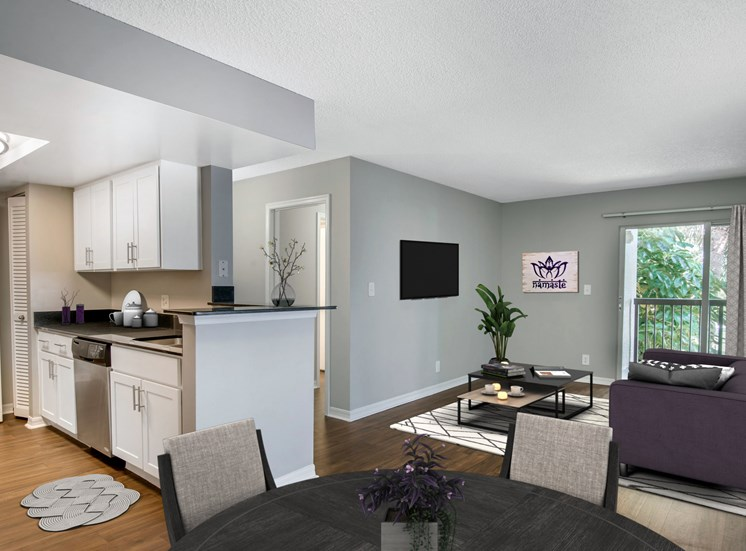 virtual staged model apartment, living room and kitchen overlooking patio