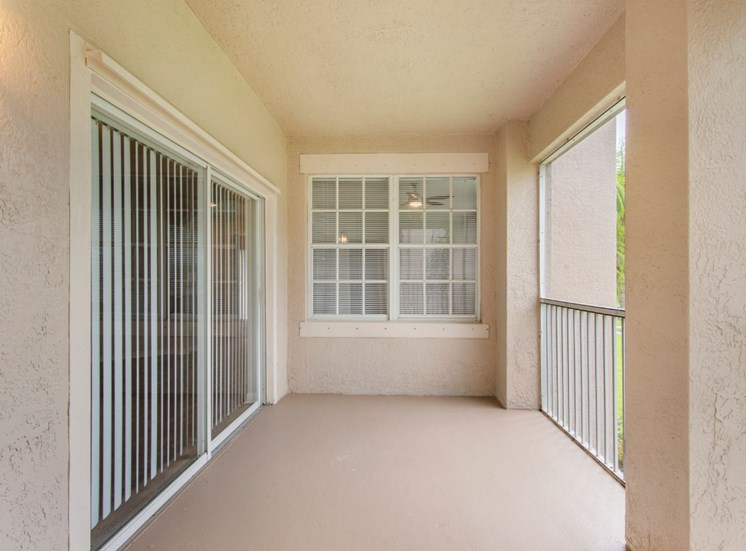 Private Balcony with Sliding Glass Doors and White  Railing