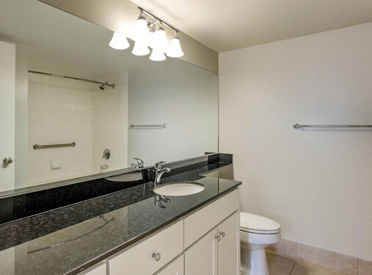 Bathroom with White Cabinets, Black Counters with Vanity Space