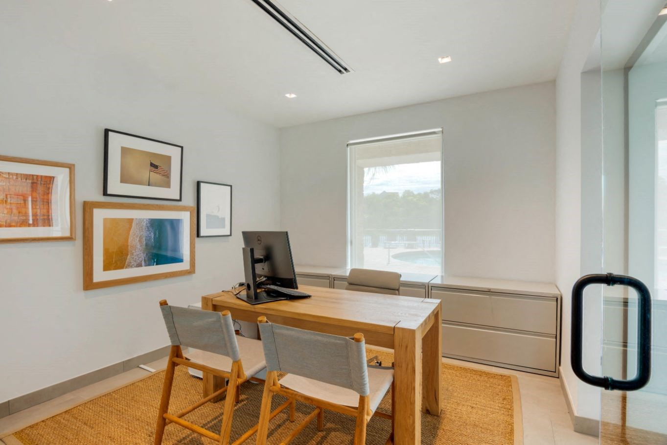 Leasing Office with art on walls and glass doors
