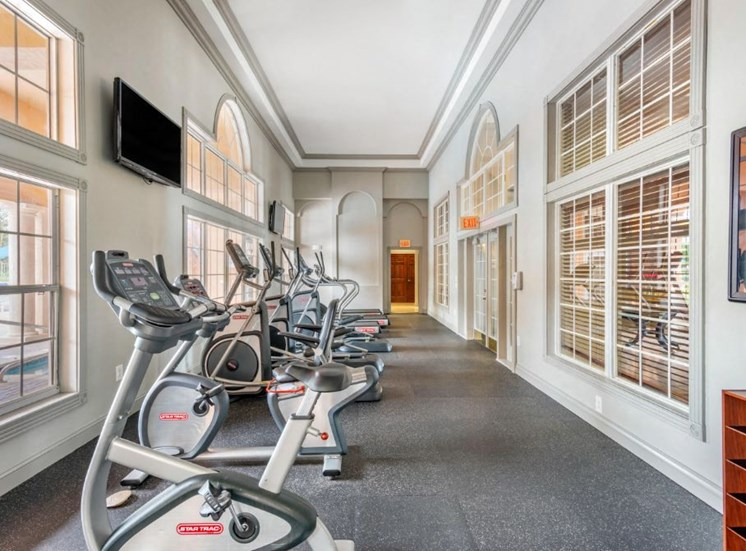 Fitness center with stationary bikes and tv