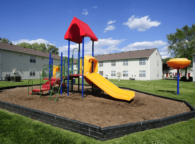 Outdoor playground with slides, latter, and monkey bars