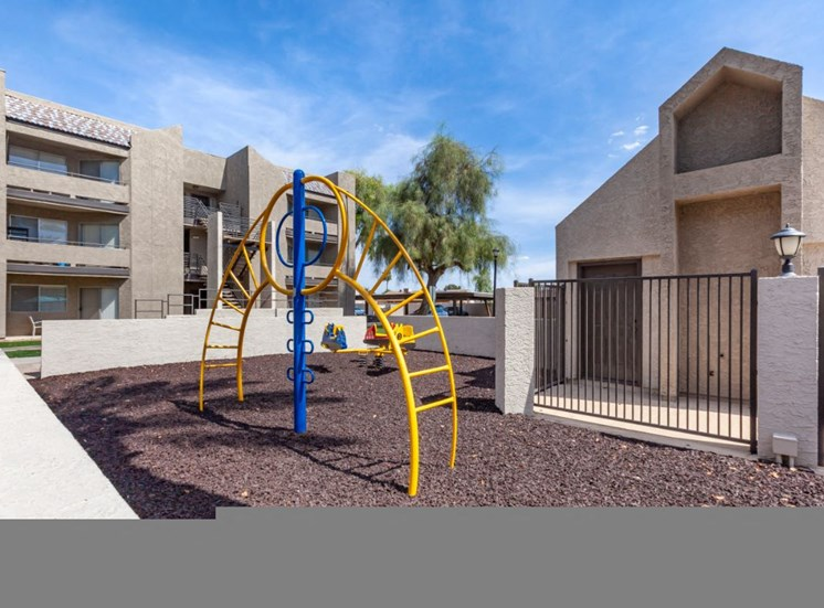Enclosed Playground with Building Exteriors in the Background