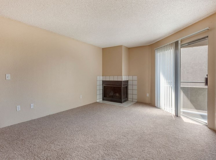 Living Room with Carpet Flooring and Fireplace