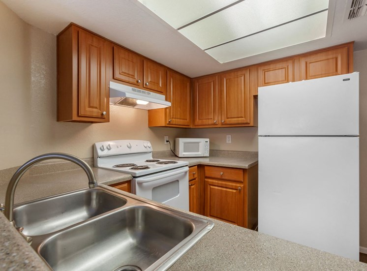 Kitchen with White Appliances and Double Basin Sink