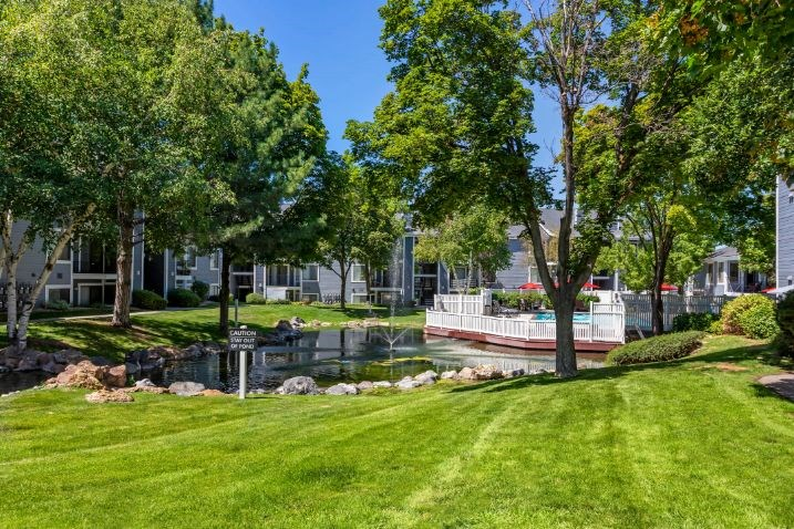 Property exterior courtyard with center lake and dock with surrounding landscape