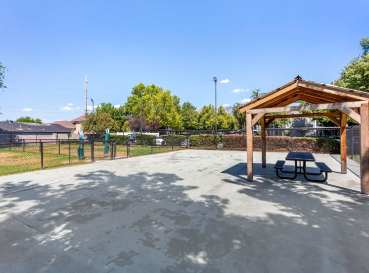 Outdoor covered picnic area and dog bark overlooking native landscaping