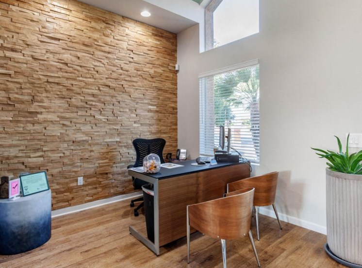 Leasing Office with Contemporary Desks and Chairs in Front of Stone Accent Wall