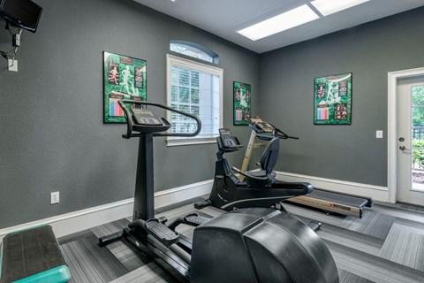 Grey Fitness Center with Window Posters Exercise Equipment