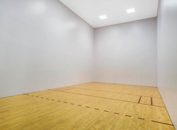 Racquetball Gym with wood floors and white walls