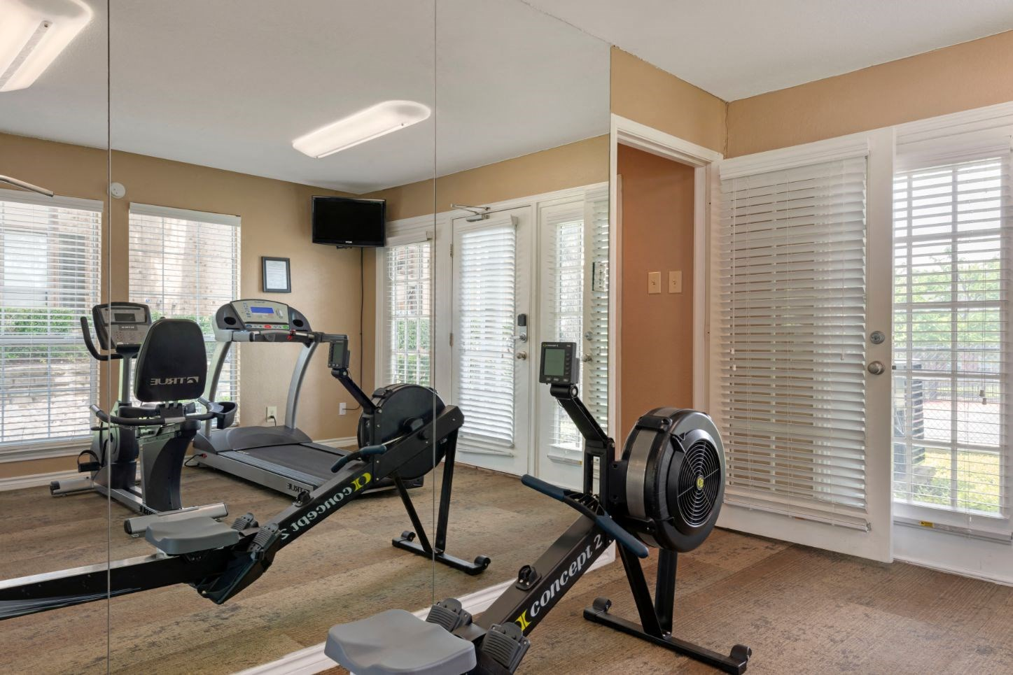 Rowing stations in the Fitness Center and a tv mounted on the wall