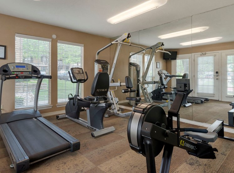 Fitness center with treadmill, other workout stations, with windows for a view