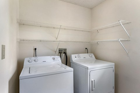 Laundry Closet with Full-Size Washer and Dryer and shelving