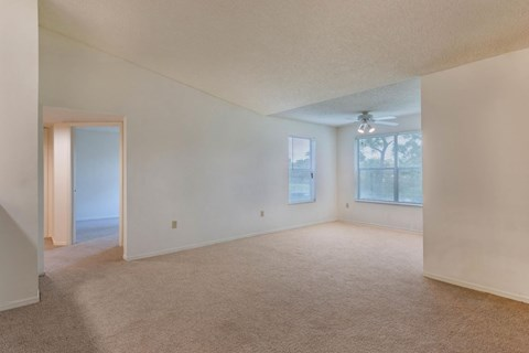 Large carpeted Living Room with additional Solarium space, carpeted throughout