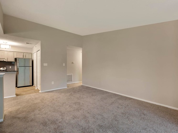 Carpeted Open Floor with Kitchen with Stainless Steel Appliances