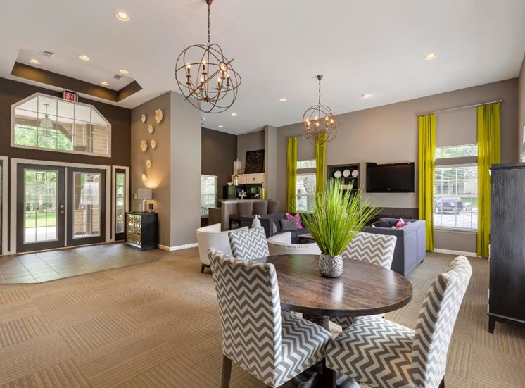 Clubhouse with Contemporary Fixtures and Decorations and Dining Table with Chevron Print Chairs