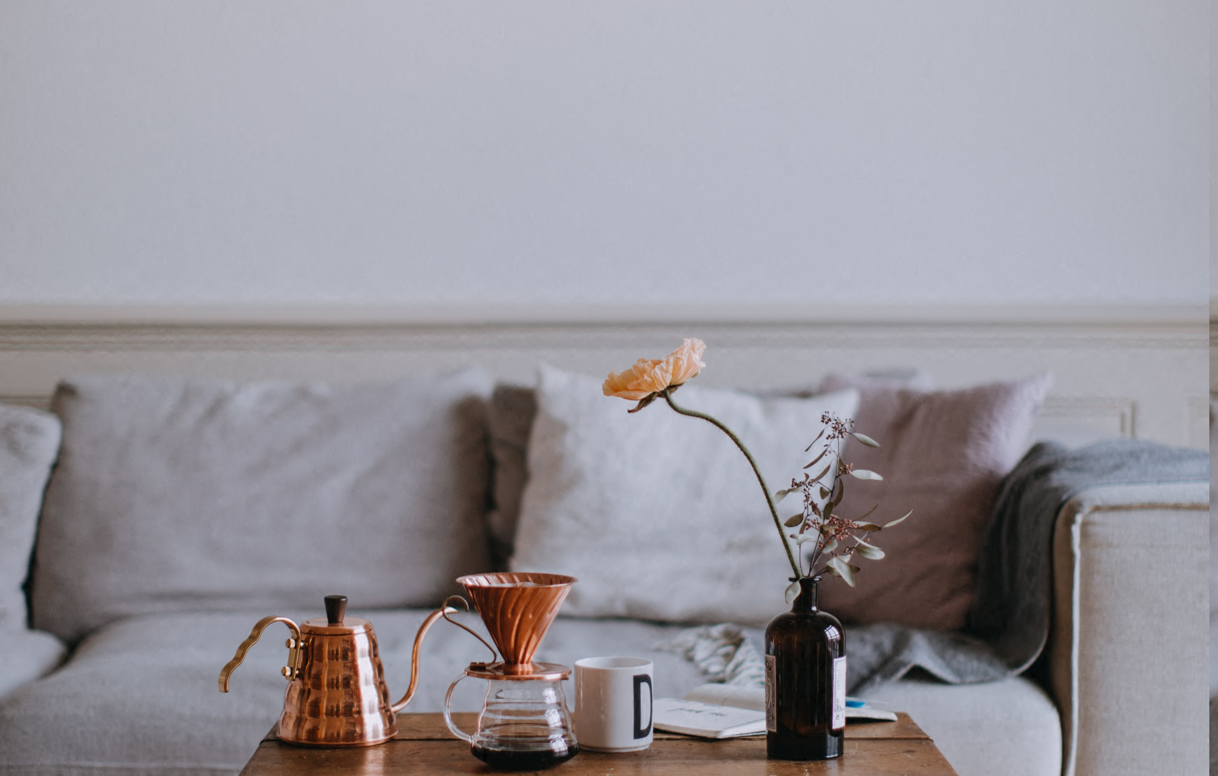 Stock Image of Living Room with Wood Coffee Table and Grey Couch