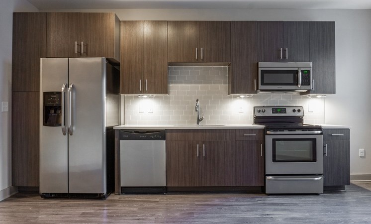 Fully equipped modern kitchen with brushed nickel appliances