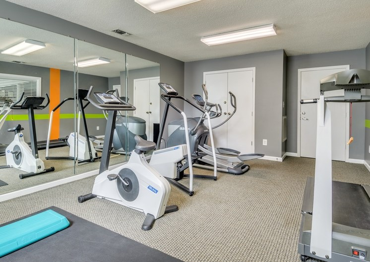 Fitness center with treadmill and stationary bikes