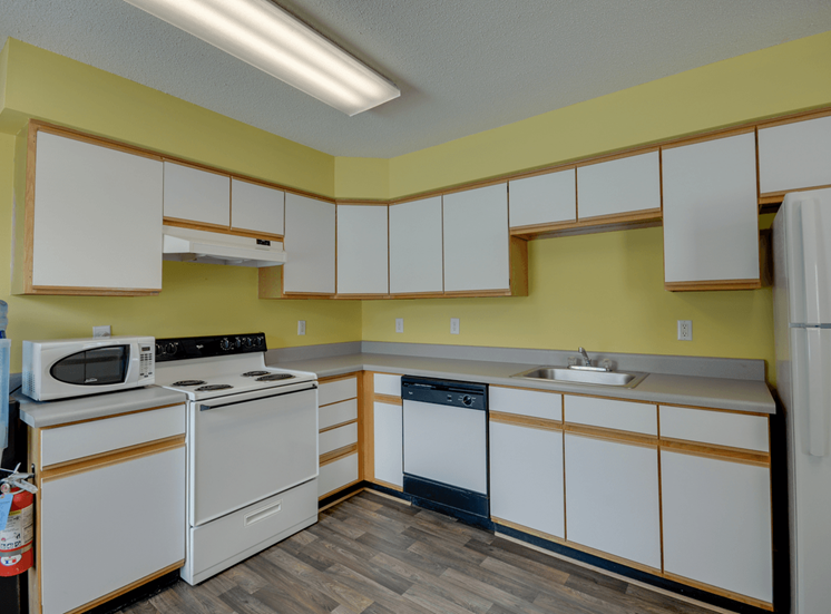 Clubhouse Kitchen with White Cabinets at King's Ridge Apartments, Virginia, 23608