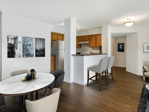 The Landings at Pembroke Lakes Apartments | Dining Room and Kitchen with Breakfast Bar