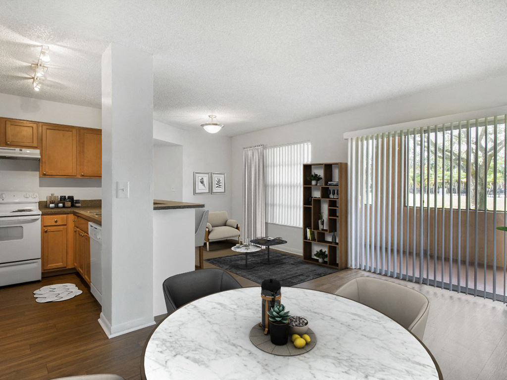 The Landings at Pembroke Lakes Apartments | Open Living Room and Dining Room with Hardwood Style Flooring