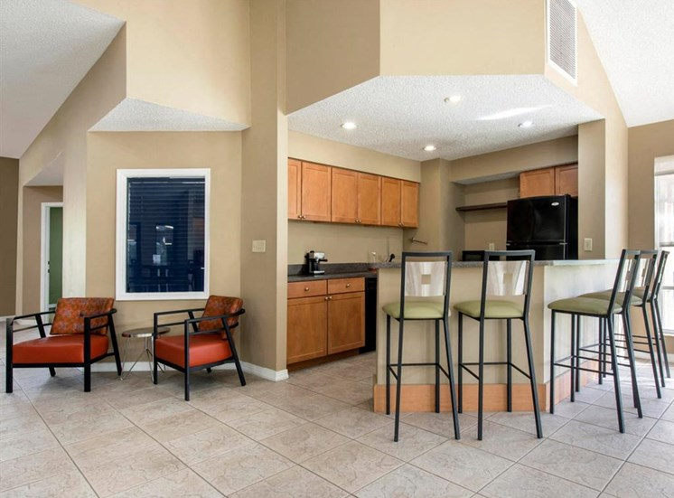 Clubhouse Kitchen with Breakfast Bar and Chairs  and Two Armcharis