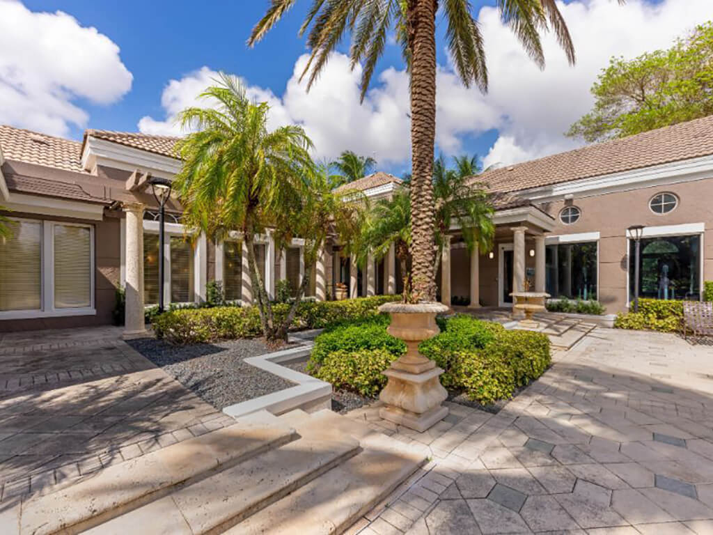 The Preserve at Deer Creek Apartments | Clubhouse Entrance with Landscaping