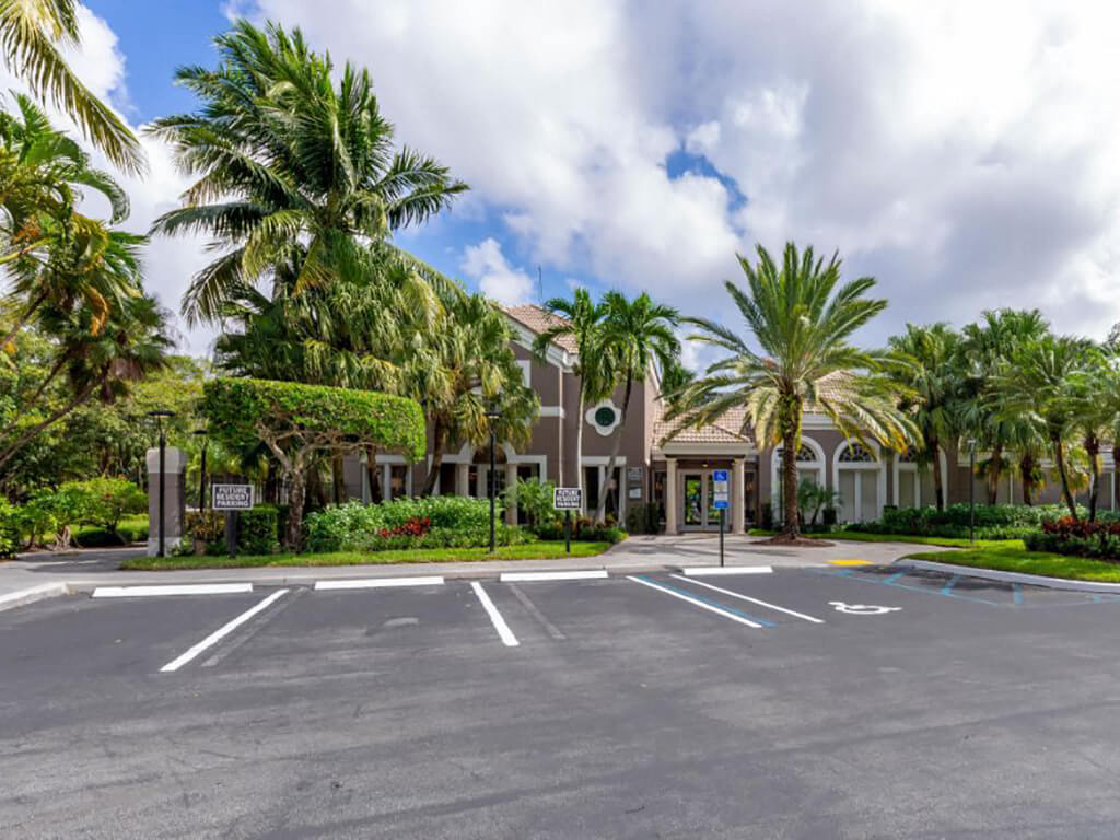 The Preserve at Deer Creek Apartments | Clubhouse Exterior with Parking Lot