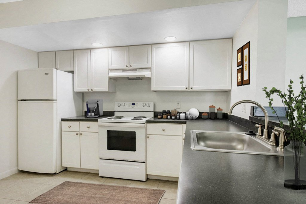 Kitchen model with white fridge, stove and white cabinets