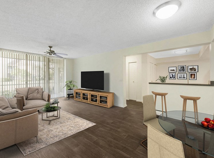 Virtual model of living room with couch, coffee table, tv stand with tv and dining room table