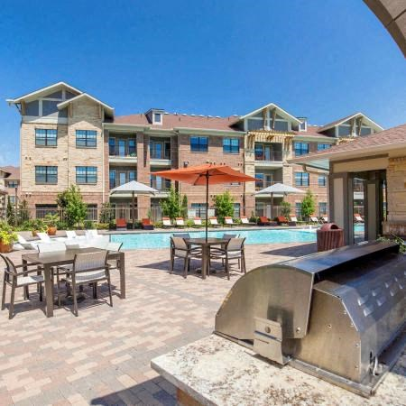 Poolside Grilling Area | Sorrel Fairview Apartments | Fairview, TX