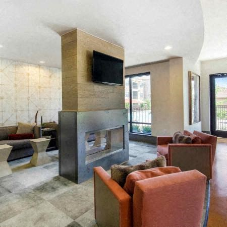 Media Lounge with Fireplace | Sorrel Fairview Apartments | Fairview, TX