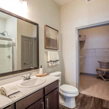 Bathroom with hardwood style flooring, white countertops,