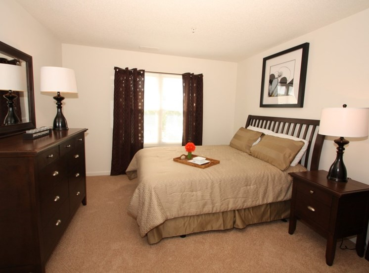 Bedroom With Expansive Windows at Autumn Wind Apartments, Winchester