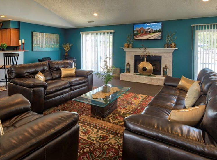 Clubhouse Seating Area With Fireplace at Bridgeport Apartments, Hampton, Virginia