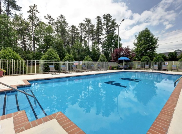 Swimming Pool and Sun Deck with Lounge Chairs at Foxridge Apartments, Durham