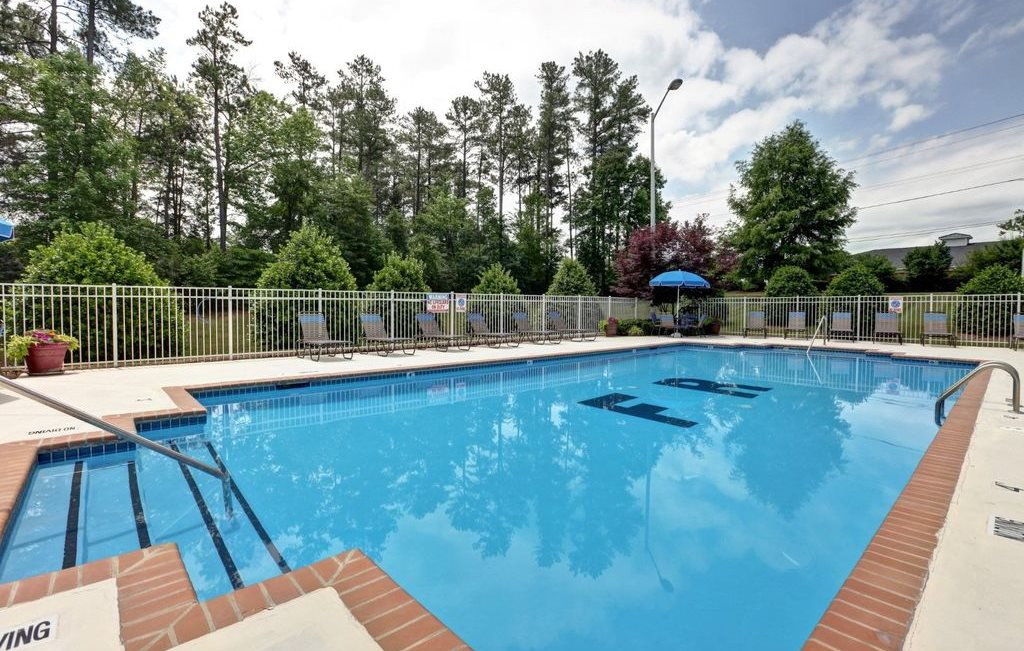 Swimming Pool And Relaxing Area at Foxridge Apartments, Durham